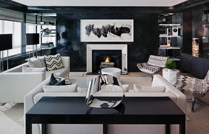 tableau noir et blanc design salon moderne meubles blancs canapé coussin motifs géométriques cheminée lampe noire sur pied