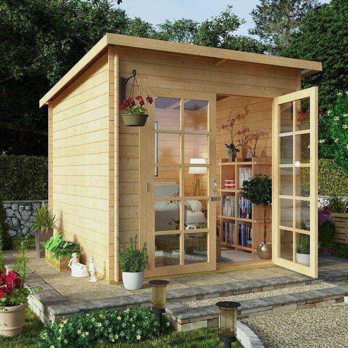 abri de jardin 12m2 en bois petit bureau de jardin confortable entouree des pots a fleurs