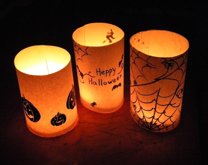 activité manuelle maternelle en papier photophore de papier orange avec motifs halloween dessinés et bougie à l intérieur