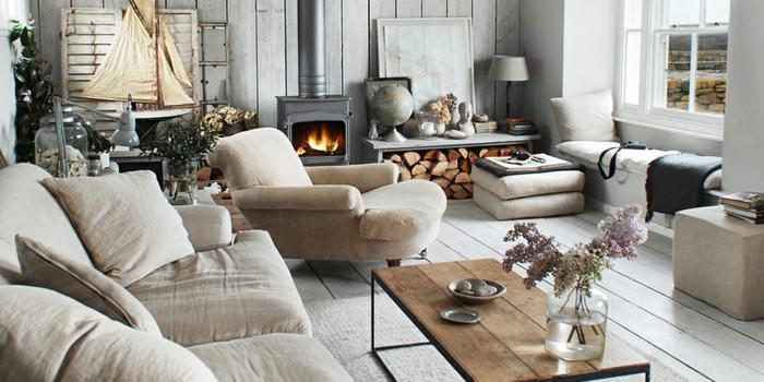 ambiance cosy salon chaleureux tapis cocooning canapé beige claire cheminée foyer ouverte