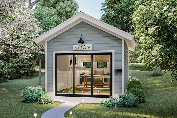 bureau cocooning dans le jardin en blue claire avec une belle toiture entouree des arbres