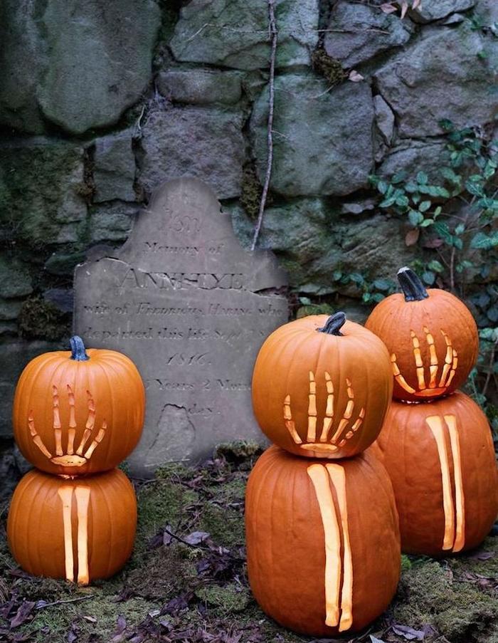 citrouilles halloween à mortif squelette et tombeau deco exterieur halloween qui fait peur