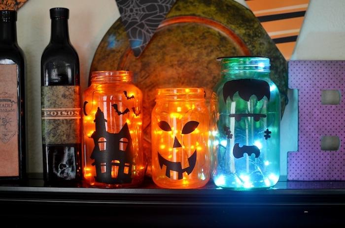 deco guirlande lumienuse halloween bocal en verre rempli de lumières colorées avec sticker halloween maison hantée jack o lantern monstre