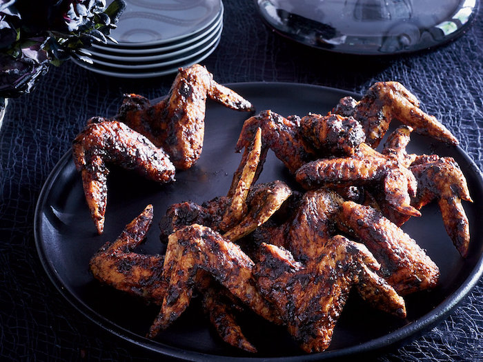 """bat"" wings (soy glazed chicken wings). a111113 food & wine halloween w/neil patrick harris & david burtka oct 2012"