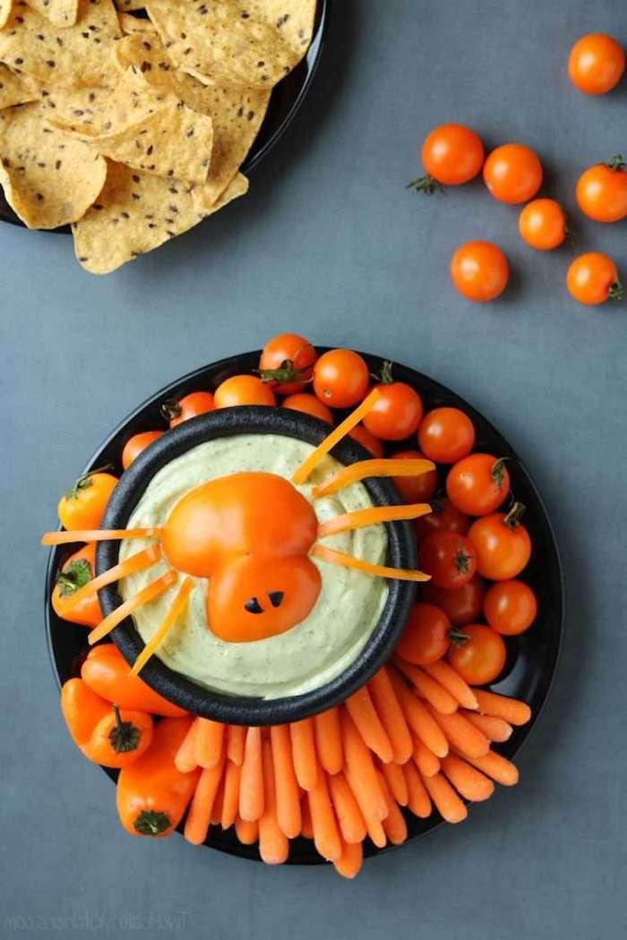 entree halloween dip araignee effrayant avec des tomates cerises et petit carrots