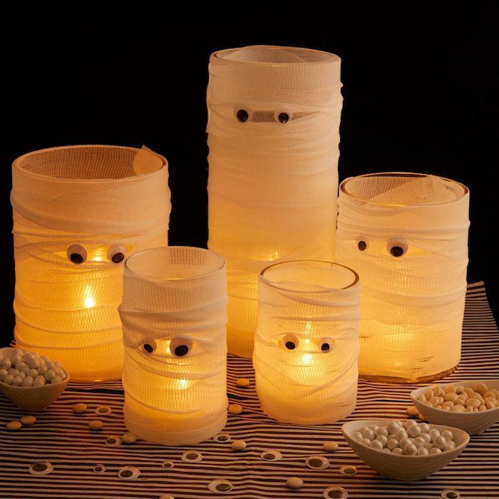 fabriquer photophore halloween motifs spectre fantome halloween avec bandeau autour de pot en verre avec des yeux mobiles activité manuelle halloween