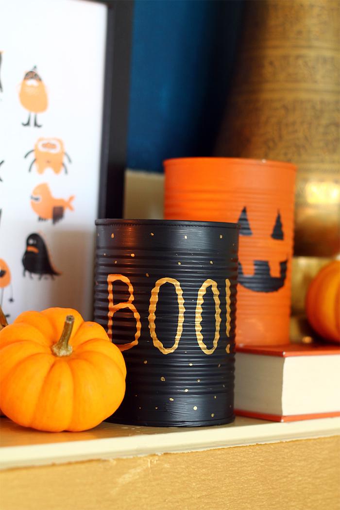 faire une decoration halloween originale dans boite de coserve recyclage creatif peinture noire ou orange et motif halloween original