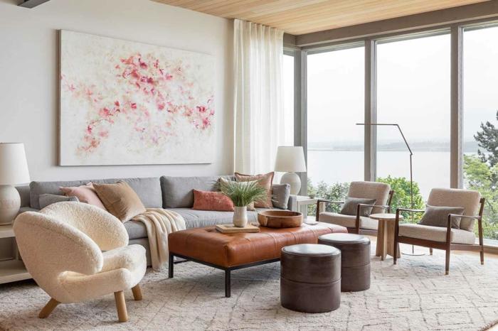 grand tableau art abstrait point focale de salon avec belle vue ambiance cocooning couleur peinture salon moderne canapé gris