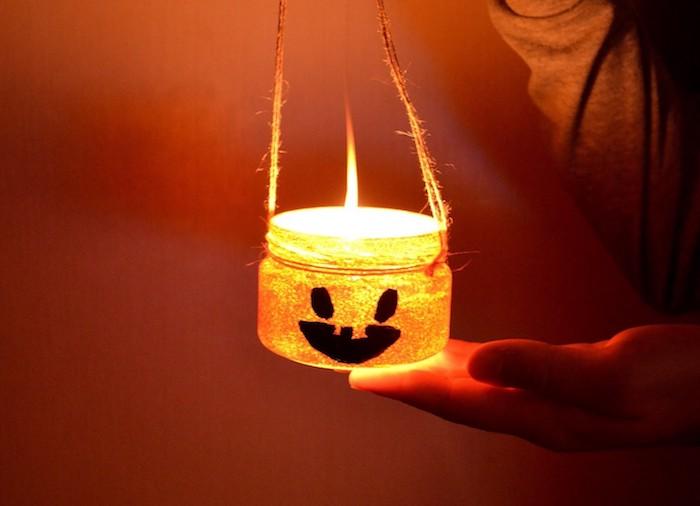 idée de photophore de halloween a faire soi meme bricolage halloween facile avec pot en verre motif jack o lantern