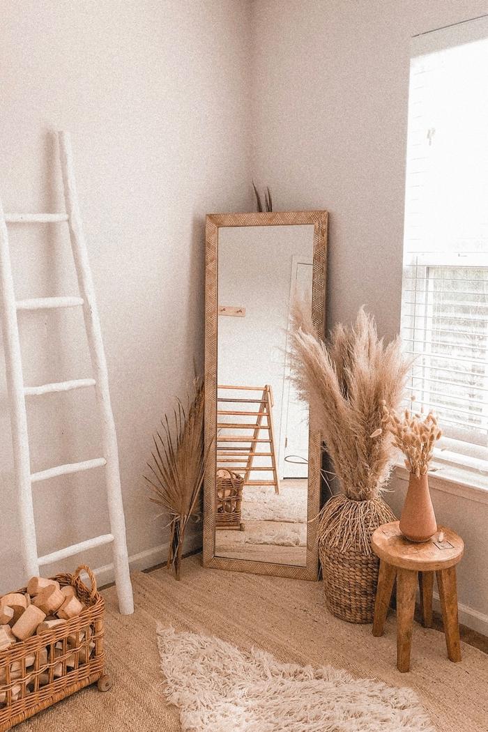 pampa sechee miroir cadre bois design intérieur style boho moderne fibre naturelle accessoires textile fausse fourrure tapis blanc