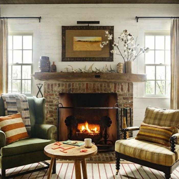 rétro salon cheminée allumée feu fauteuils couleur peinture salon le style scandinave petite table ronde