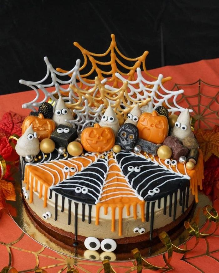 art décoration pâtisserie gateau halloween araignée chocolat glaçage blanc yeux sucre fantômes monstre citrouille sucre