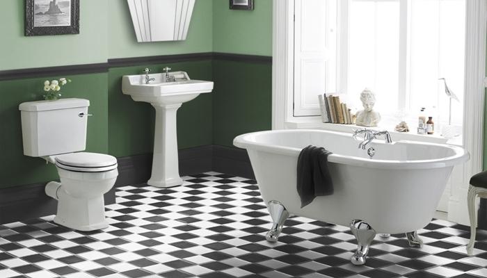 carrelage salle de bain retro motifs carreaux baignoire sur pied peinture murale vert foncé cadre photo noir