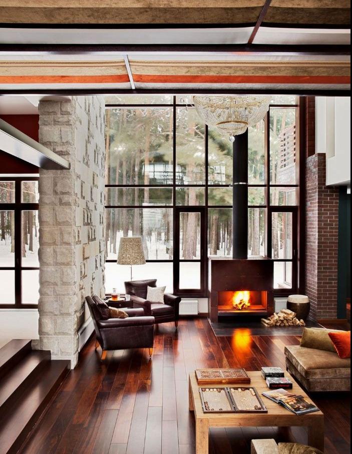 cheminée design parquet bois foncé table basse bois et mobilier gris lustre elegant salon rustique deco originale