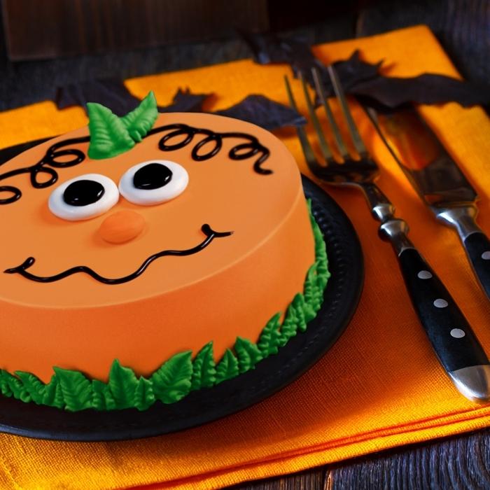 chocolat fondu pâte sucre colorant alimentaire courge halloween visage citrouille yeux fondant blanc nez feuilles