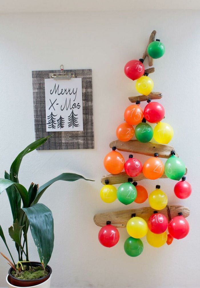 comment faire un calendrier de l avent facile en batonnets de bois et ballons avec chiffres et surprises à l intérieur