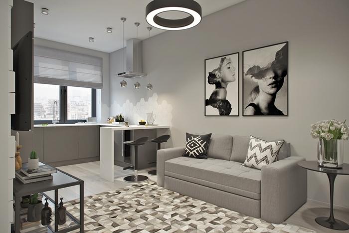 cuisine appartement décoration stylée peinture murale gris art portrait femme blanc et noir éclairage led îlot bar