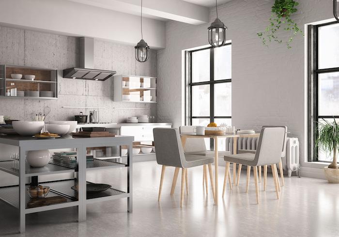 cuisine ouverte bar une idee d amenagement en style minimaliste avec un bar en metal et petite table au centre de la piece