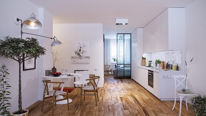 décoration coin cuisine parquet bois table ronde blanche chaise bois lampe sur pied métal inox cuisine blanche