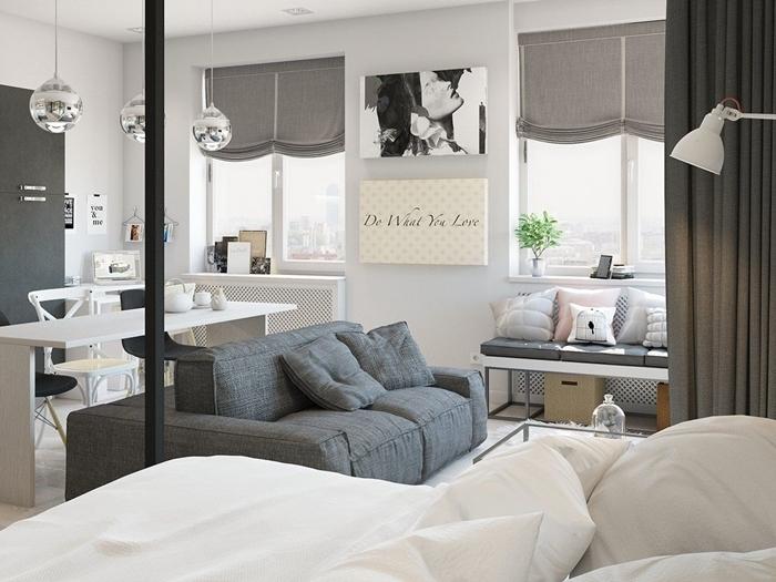 décoration intérieure plan ouverte canapé gris anthracite banquette fenêtre coussins décoratifs aménagement cuisine studio
