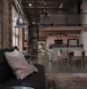 decoration loft coussin marron canape noir mur briques rouges design mezzanine installation filet habitation