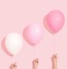 des ballons en differentes nuances de rose avec trois mains fond d ecran pastel esthetique pop art