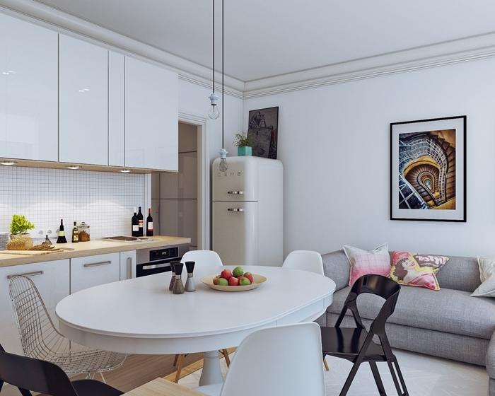 design intérieur moderne table à manger ronde cuisine pour studio blanche avec plan de travail bois clair éclairage led spots