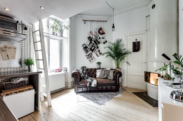 idée petite cuisine inox plan de travail gris anthracite lit mezzanine éclairage spot led canapé cuir marron foncé