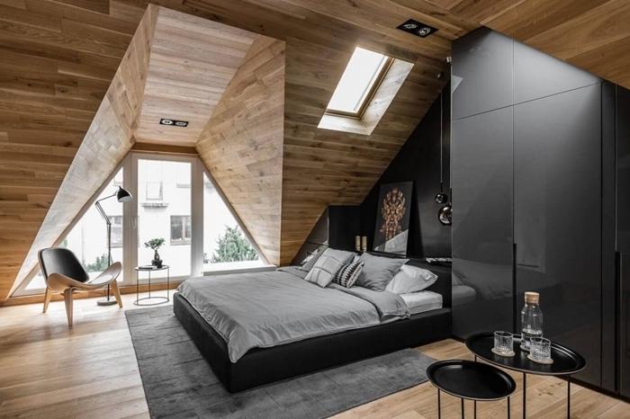 panneaux bois mur revêtement chambre avec dressing noir moderne sans poignée cadre de lit cuir noir tapis gris anthracite
