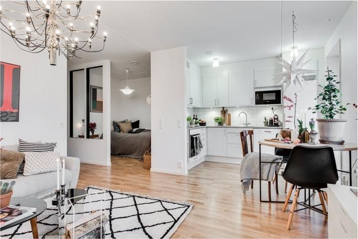 petite cuisine d angle décoration cuisine blanche avec pla de travail gris canapé blanc tapis moelleux blanc et noir