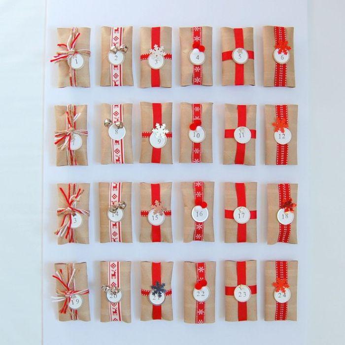 rouleaux de papier toilette recyclés et décorés de ruban rouge avec numéro idée calendrier de l avent simple a faire