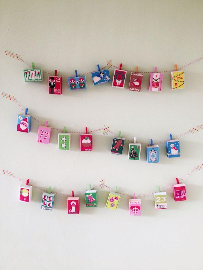 boites d a llumettes à motif noel enveloppe originale suspendues sur des fils avec des pinces à ligne exemple commet faire un calendrier de l avent