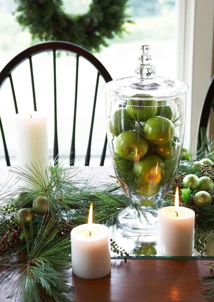 bol fruits pommes vertes table de noel décoration nature centre de table bougies blanches branches de sapin