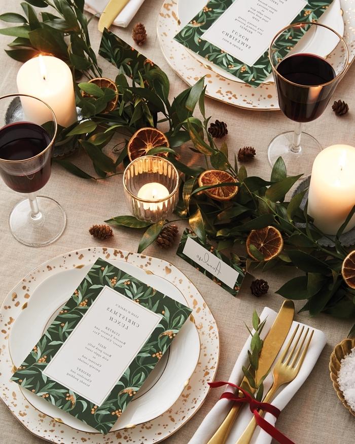 cadeau de table noel bougie blanche verre cristaux branches verdure tranches orange fruits séchées couvercle or