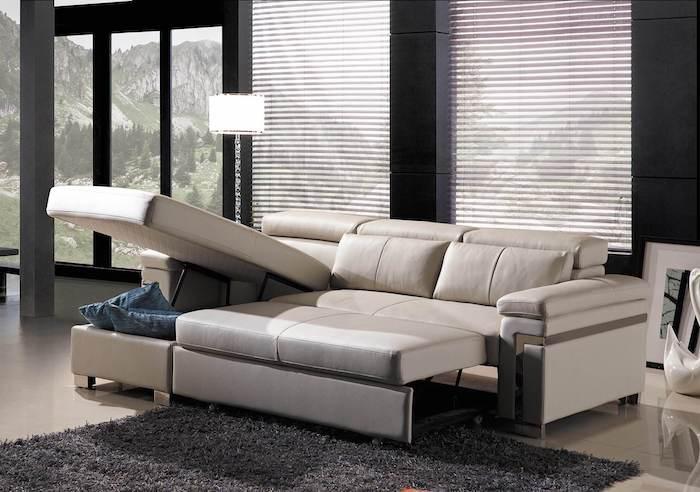 canapé d angle convertible avec un coffre en cuire beige creme style minimaliste