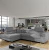 canape angle covertible en textile gris dans une salle de sejour avec des grandes fenetres