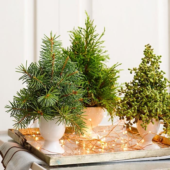 centre de table diy facile vase blanc branches de sapin guirlande lumineuse décoration de noel fait maison rustique