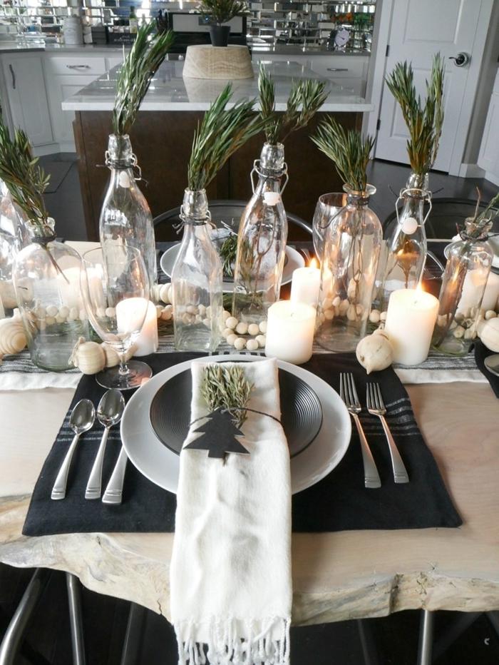 deco table noel nature style campagne guirlande diy en perles de bois bougies blanches bouteille verre branches vertes