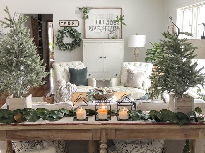 design intérieur style rustique salon blanc et bois deco noel a faire soi meme centre table branches vertes nature bougies