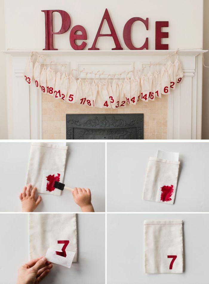 exemple pour fabriquer un calendrier de l avent en sachets cadeau diy en chiffres de peinture rouge rangées au dessus de la cheminée