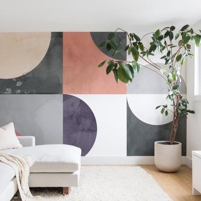 peinture géométrique design salon moderne revêtement de sol parquet bois tapis moelleux blanc canapé d angles blanc