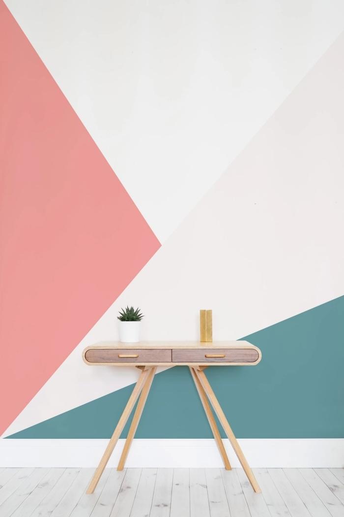 peinture geometrique moderne commode meuble bois accessoires déco pot fleur blanc parquet bois gris clair mur accent