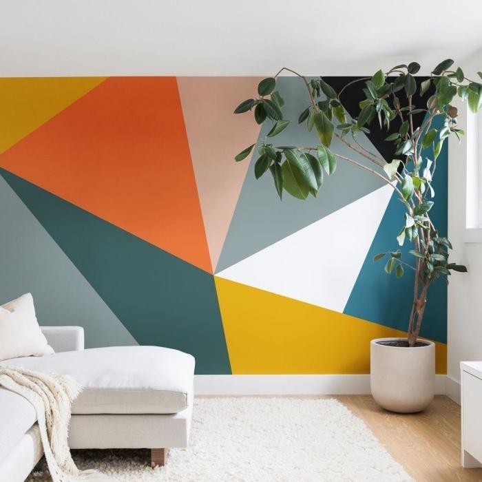tapis moelleux blanc peinture triangle chambre multicolore plante verte pot fleur blanc sol bois parquet meubles blancs