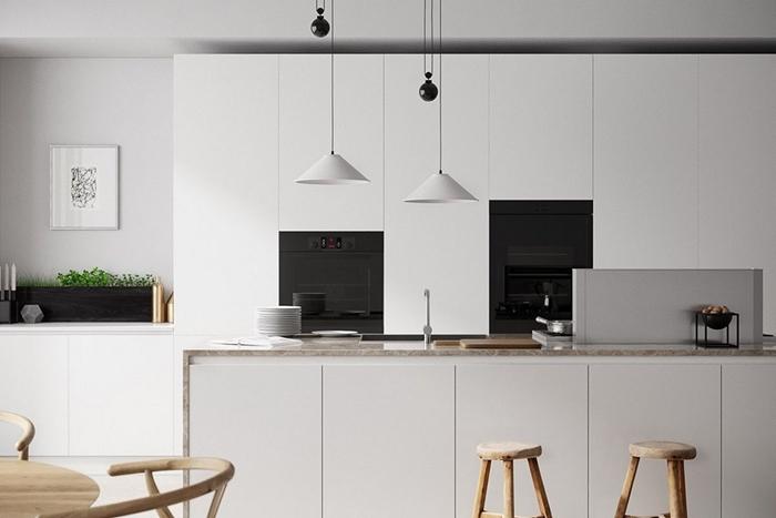 cuisine ilot central moderne armoires blanches mechanisme ouverture automatique lampe suspendue blanc mat