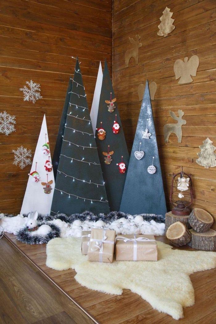 deco noel en carton avec des sapin triangles et de fausse neige dans un cabin de log style rustique