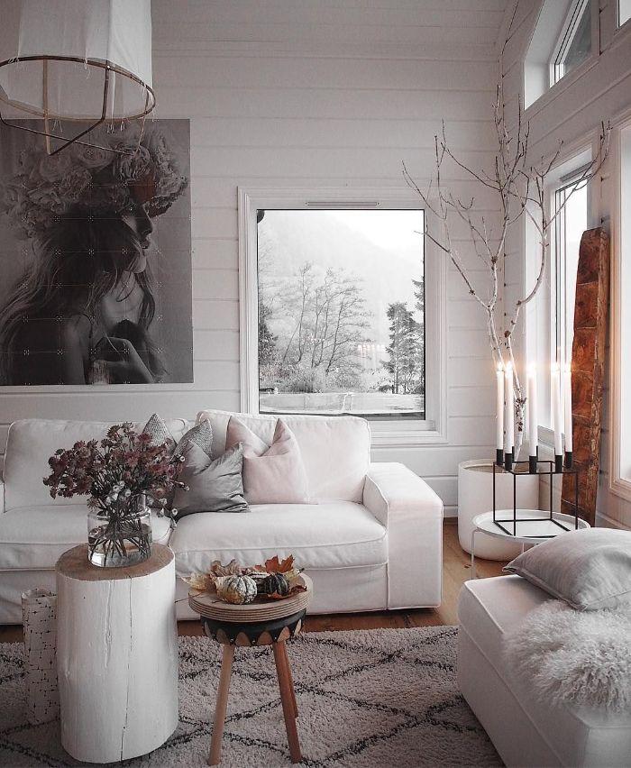 deco salon hiver espace cocooning en blanc avec mobilier tout blanc table tronc blanchi murs blancs accesnts boisés