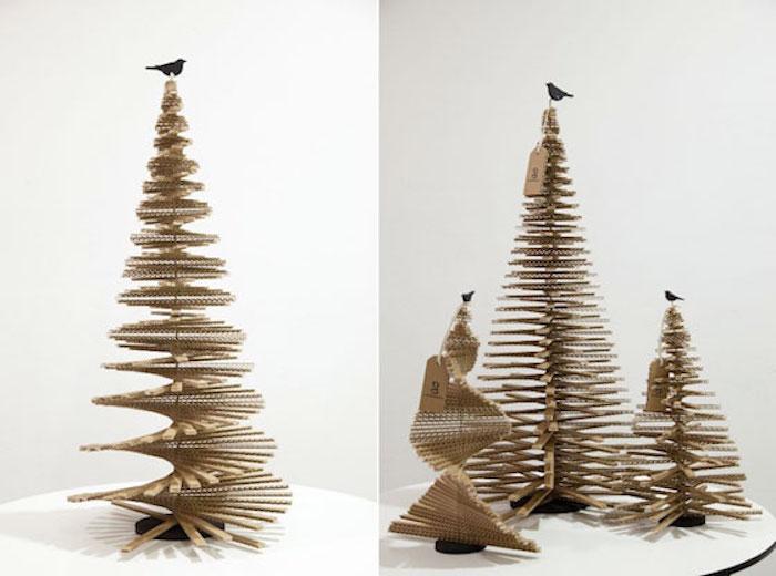 diy sapin de noel a l aide des morceaux en carton en forme d une spirale avec des petis oiseaux