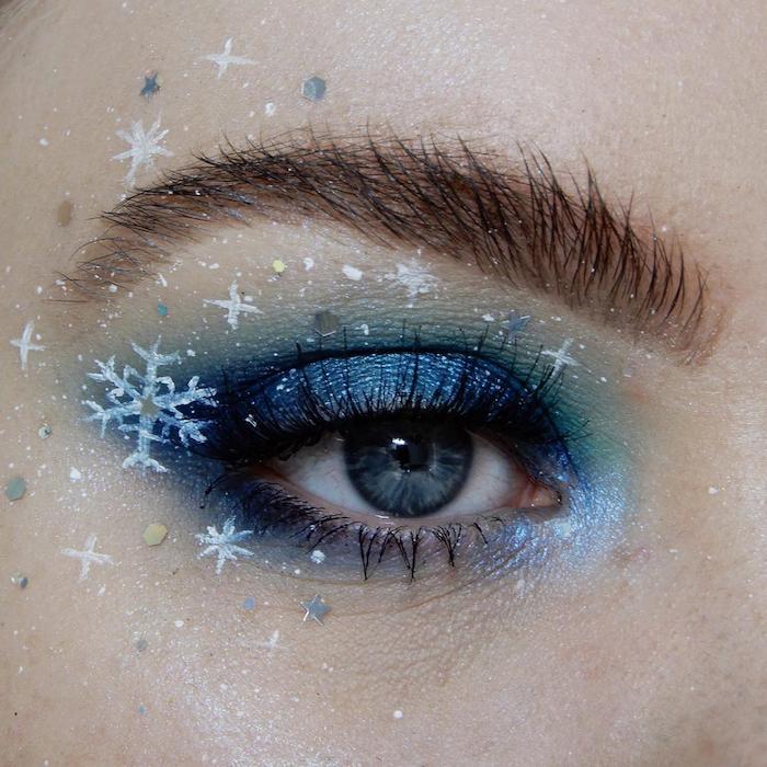 maquillage nouvel an avec des flocons de neige dessinnees maquillage pour des yeux bleus