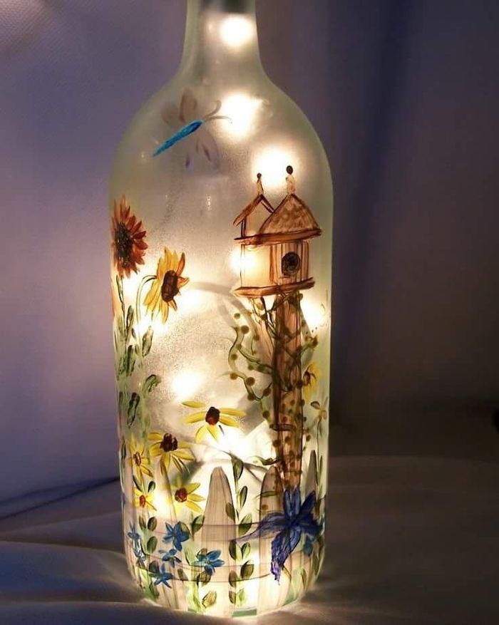activités manuelles adultes pour peindre une bouteille d eau et d y mettre des lumières