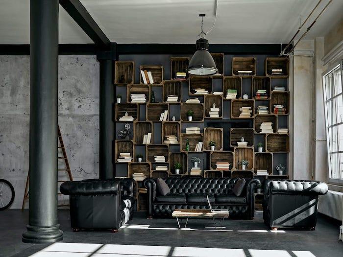 déco intérieur moderne un salon avec des canapés en cuir et une biblioteque rustique et une table basse